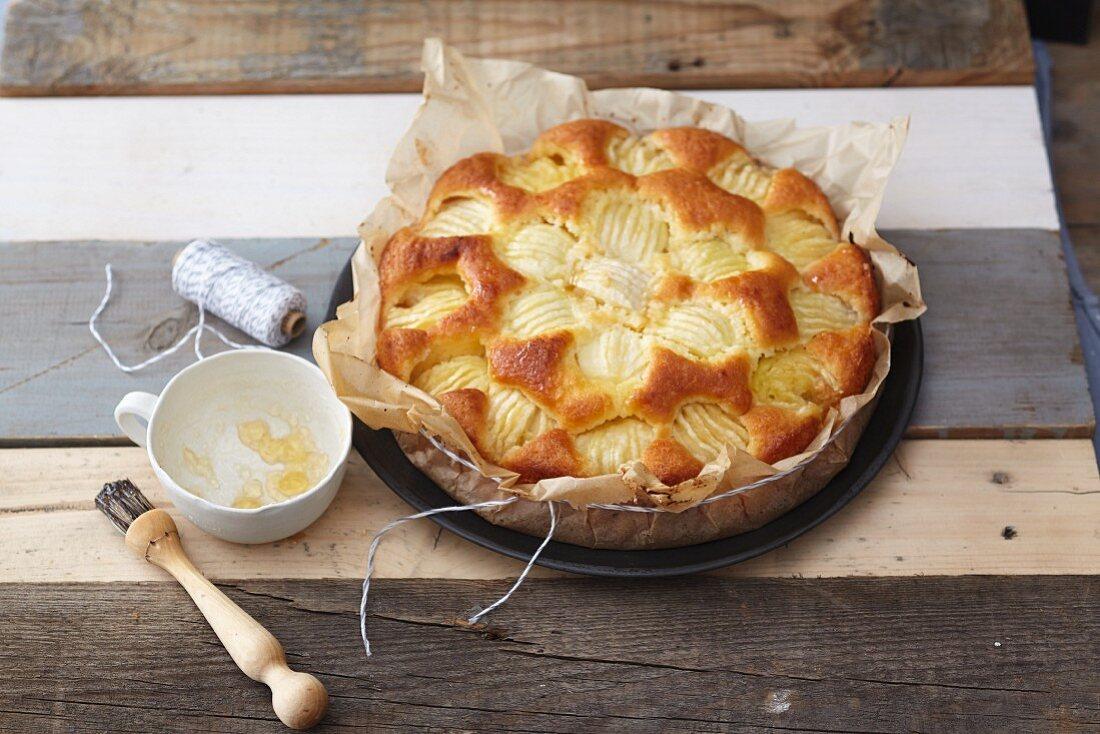 Sunken apple cake with almonds