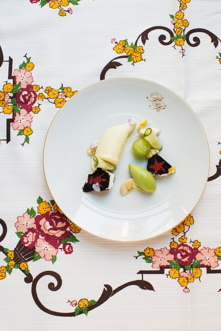 Variations on banana and cucumber with edible flowers