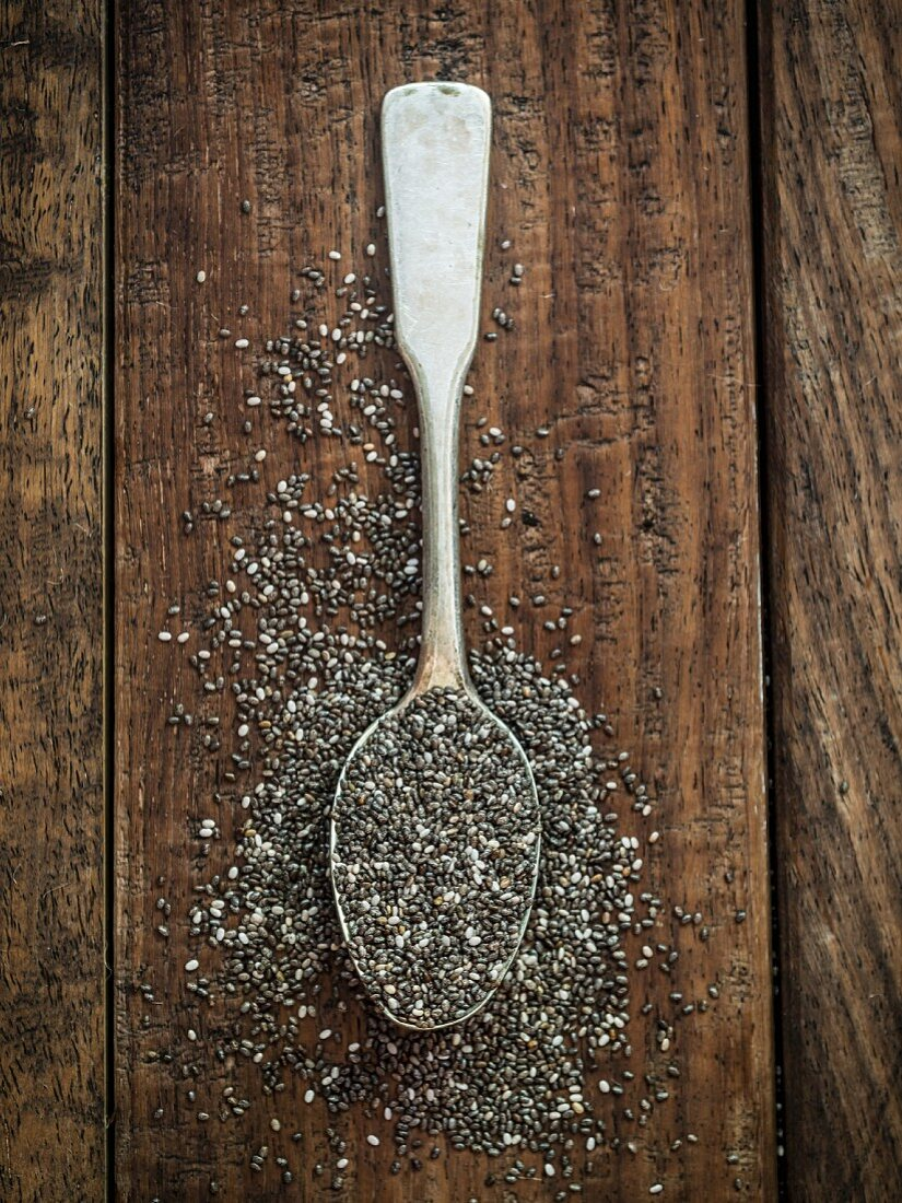 Chia seeds on a silver spoon (seen from above)