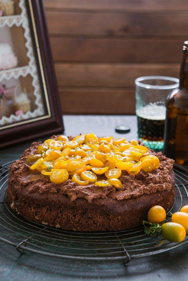 Chocolate cake with stout and kumquats