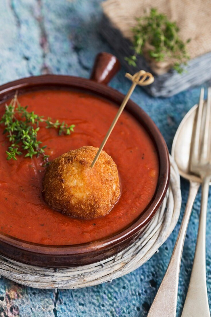 Arancini in tomato sauce with fresh thyme