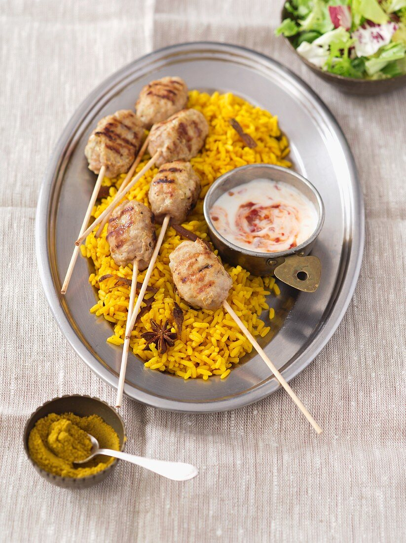 Curried rice with koftas and yoghurt sauce