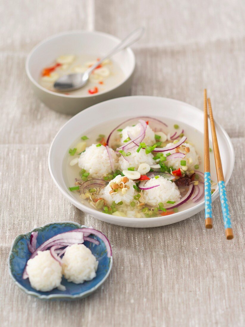 Chicken broth with ginger, chilli, garlic, anise, red onions, Brussels sprouts and rice balls