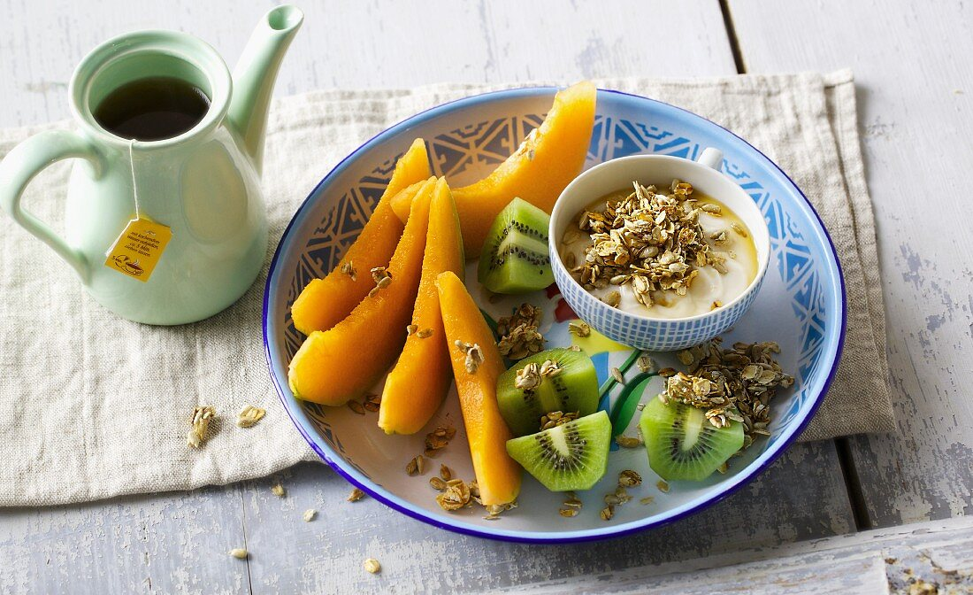 Fresh honeydew melon and kiwi with seeded soy yoghurt