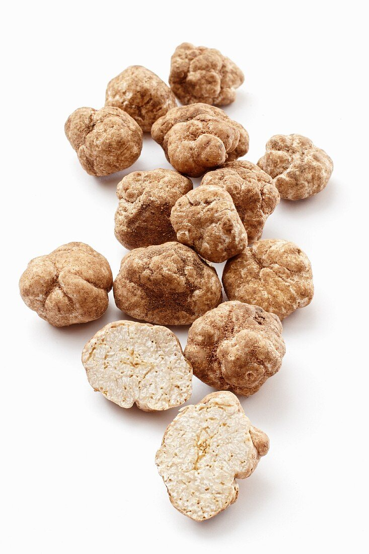 Fresh white truffles, whole and halved