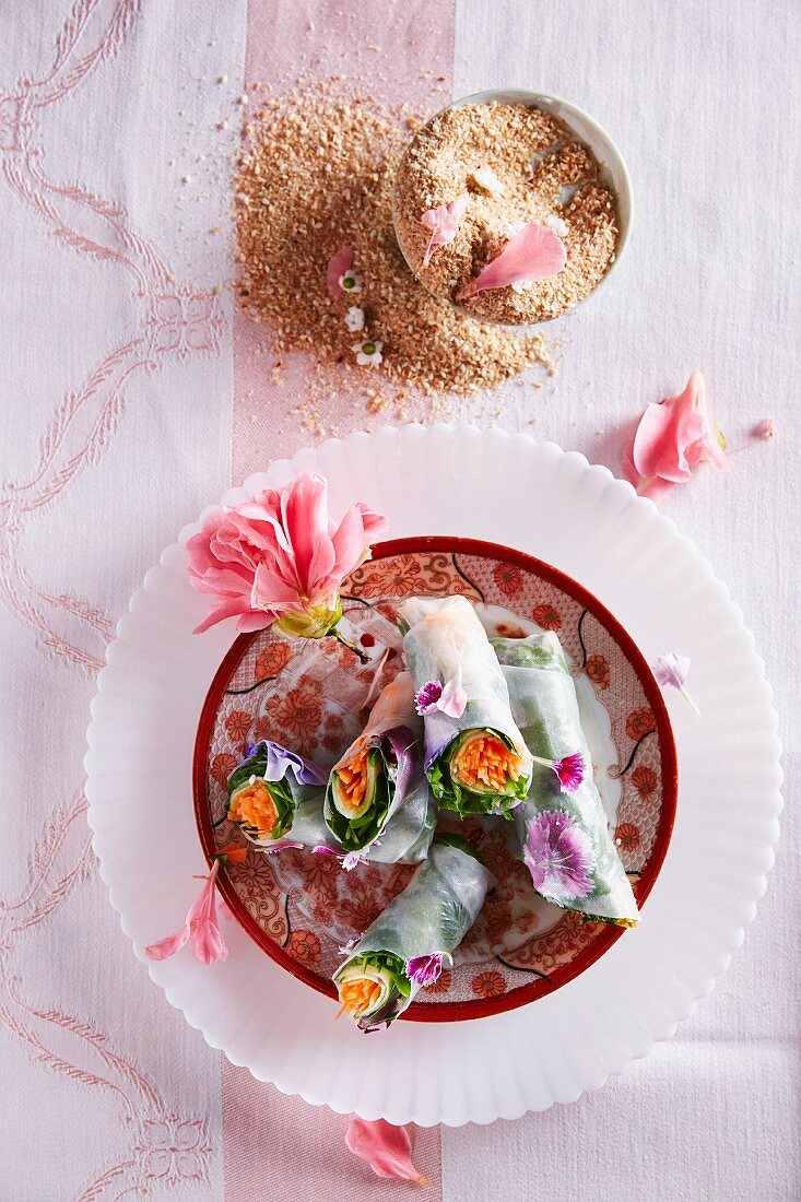 Rice paper spring rolls with flowers and a coconut and ginger dip