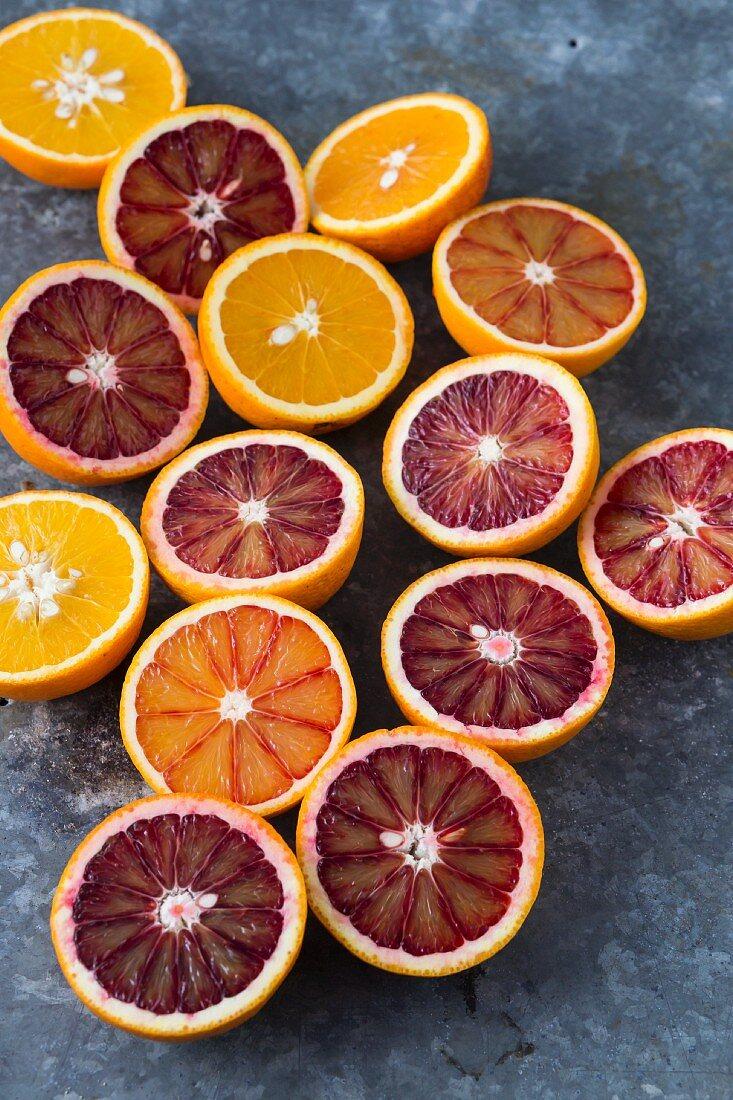 Halved oranges and blood oranges