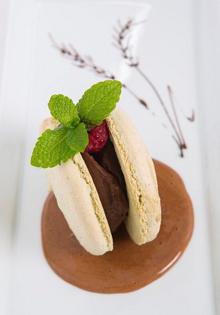 A macaroon with chocolate cream and raspberries