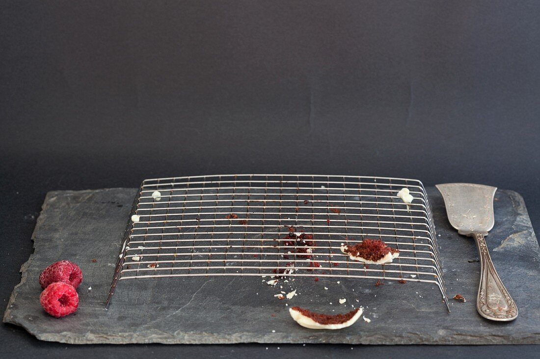 The remains of a Red Velvet cake on a wire rack
