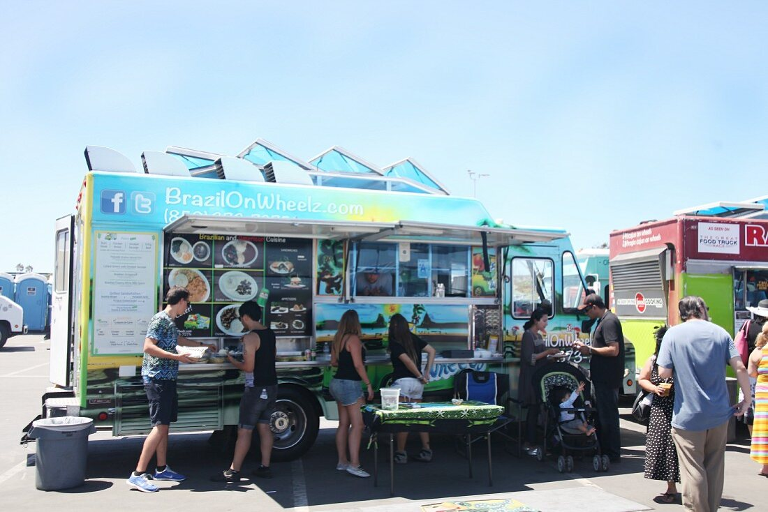 People buying fast food at a food truck festival in California, USA