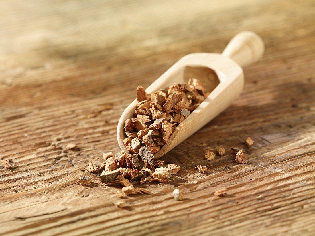 Oak bark in a wooden scoop