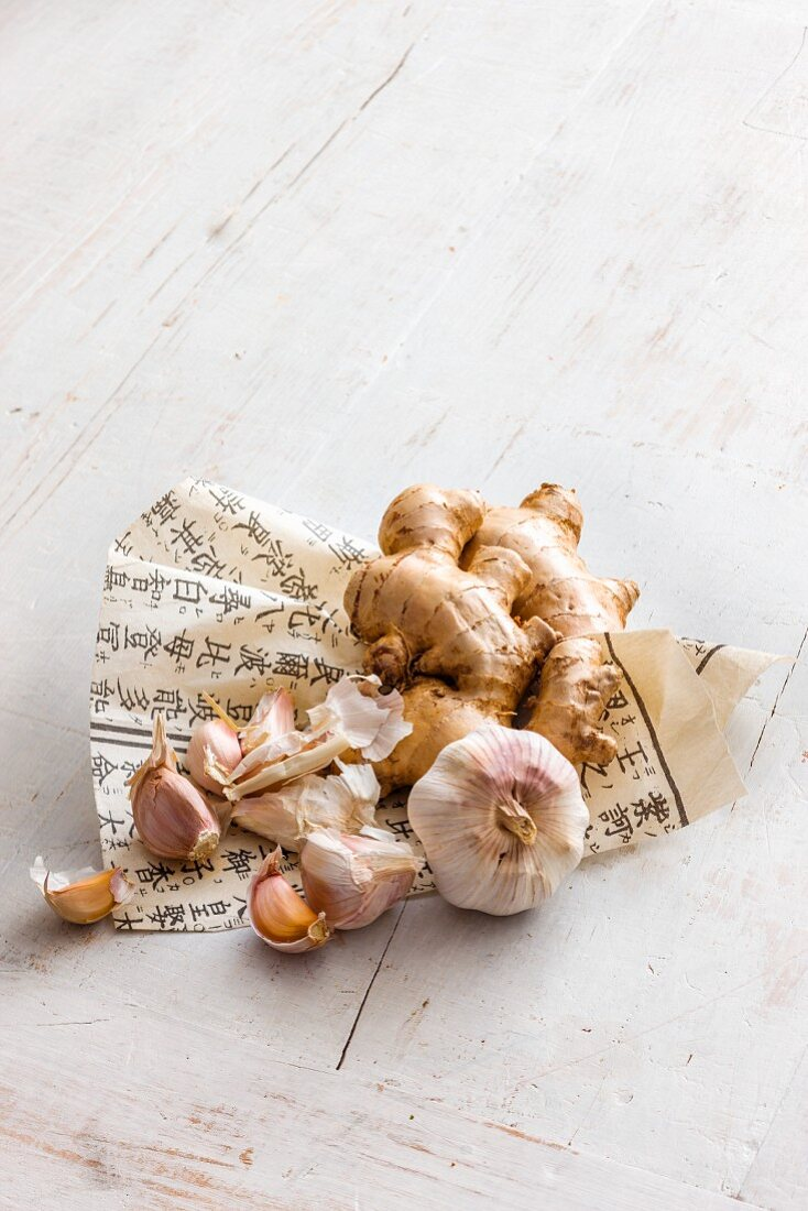 Garlic and ginger on a piece of paper