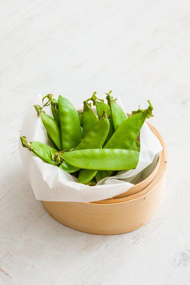 Mange tout in a bamboo basket