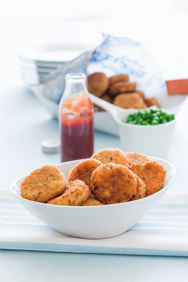 Crispy fishcakes with ketchup and peas