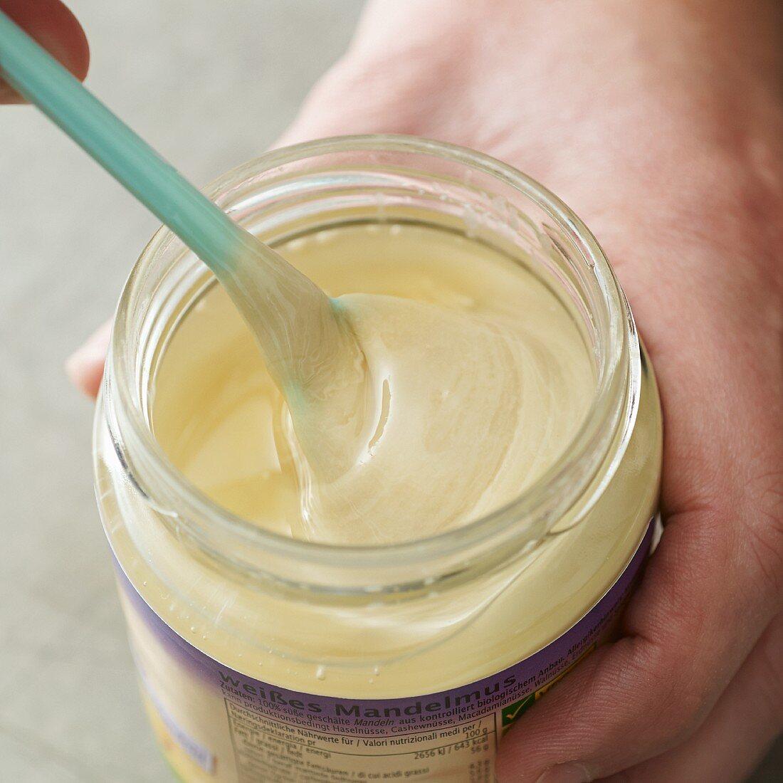 A jar of vegan almond mousse