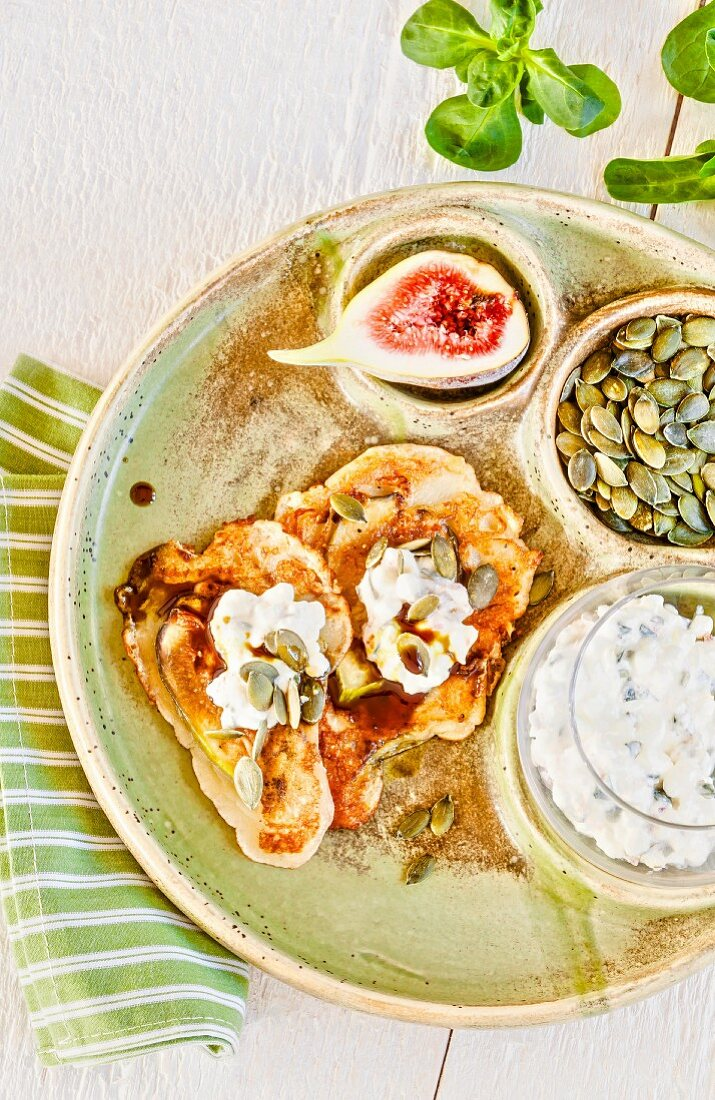 Fig cakes with cottage cheese and pumpkin seeds