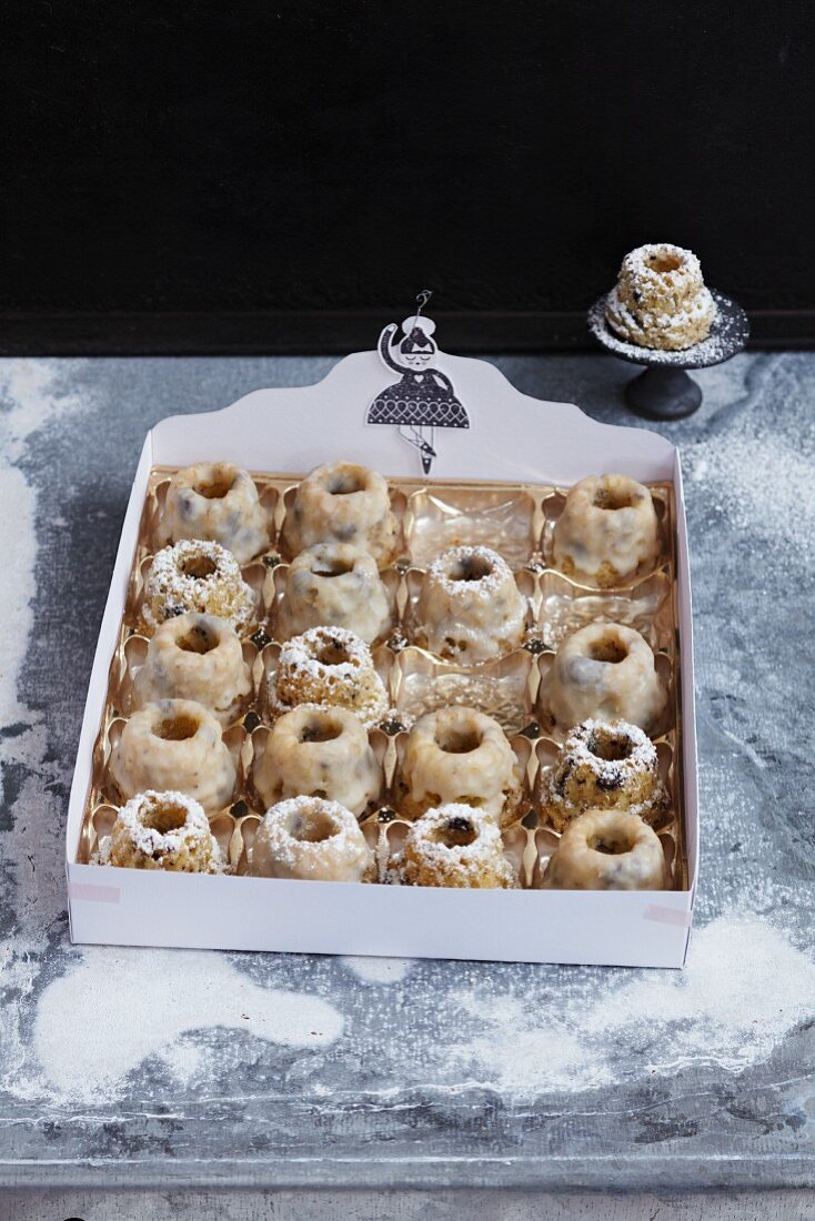 Mini Bundt cakes with an egg liqueur glaze as a gift in a chocolate box