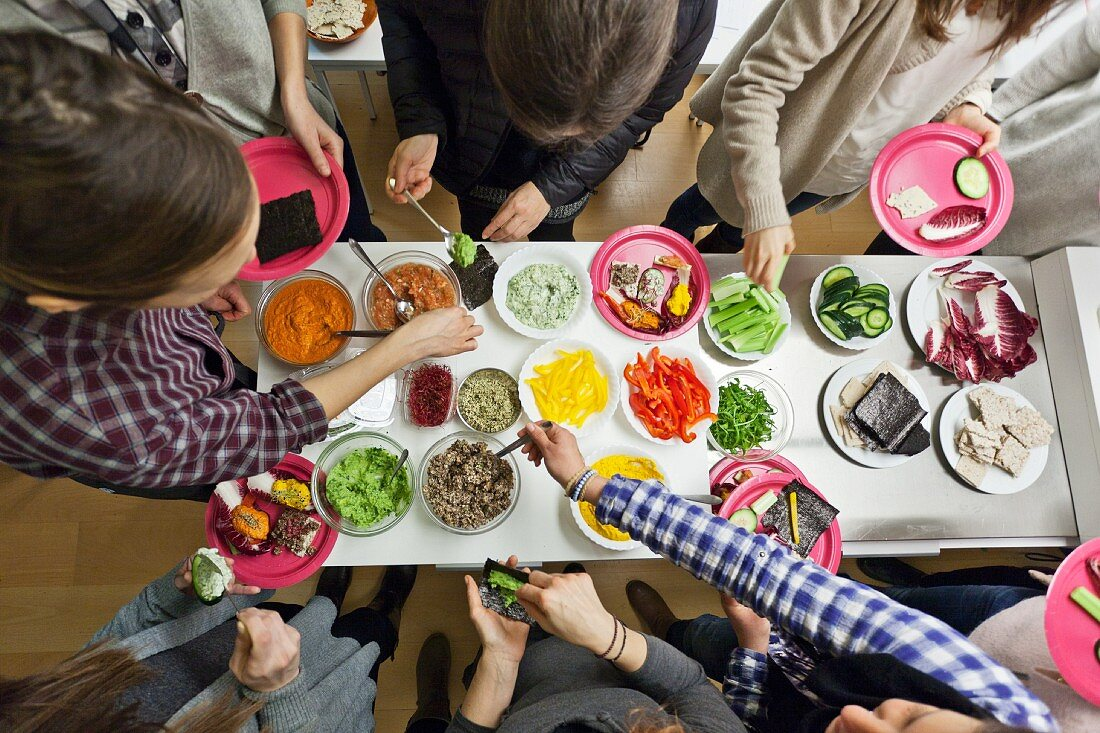 An aerial view of party guests at a vegan buffet