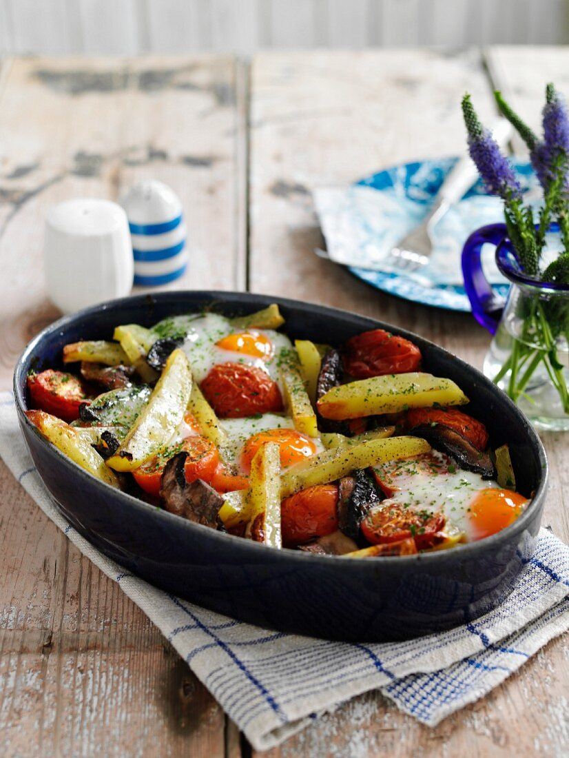 Oeuf cocotte with mushrooms, tomatoes and potatoes