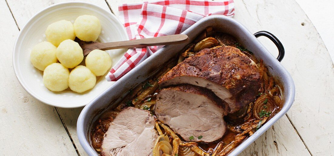 Roast pork with dark beer sauce and potato dumplings