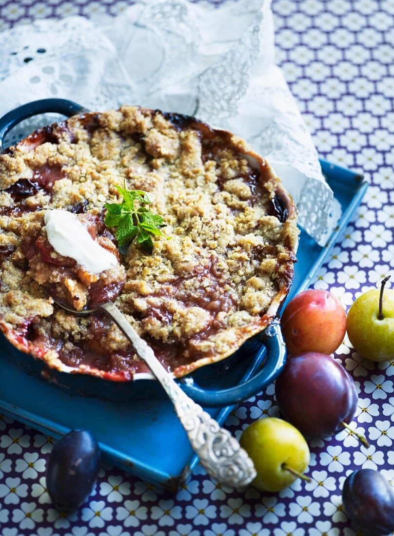 Plum crumble cake in a baking tray