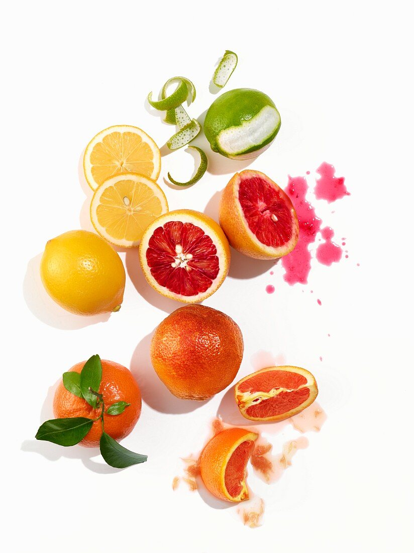Various citrus fruits on a white surface