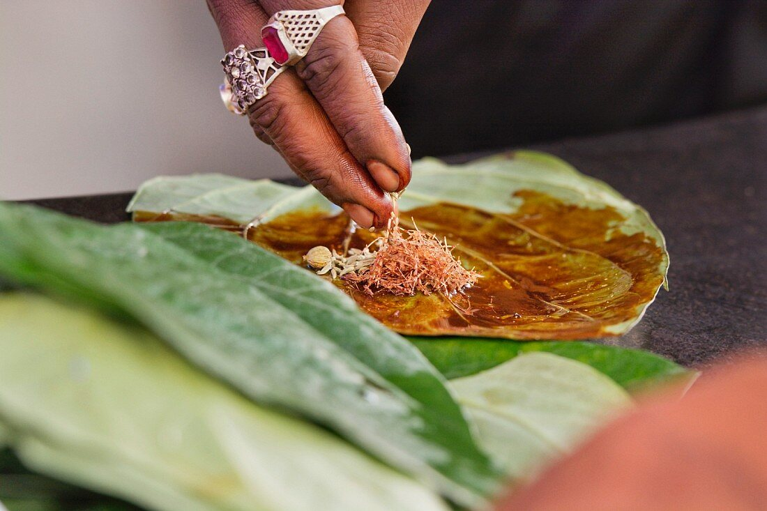 Paan being prepared - betel leaves with areca nut, popular in Indian for chewing