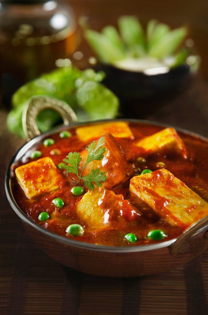 Shahi paneer – festive Indian dish made from curd cheese in a spicy tomato sauce