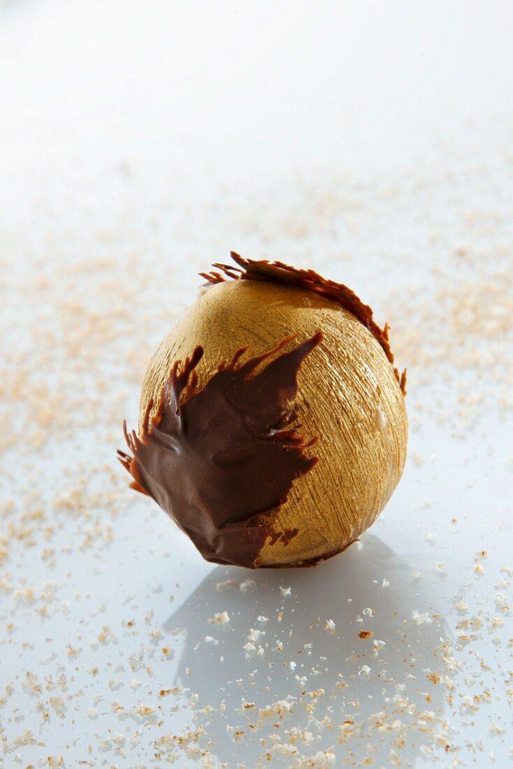 A golden ice cream hazelnut with a caramel core