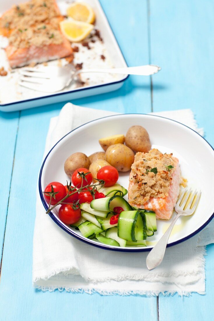 Baked salmon with a horseradish crust, potatoes, cherry tomatoes and courgette