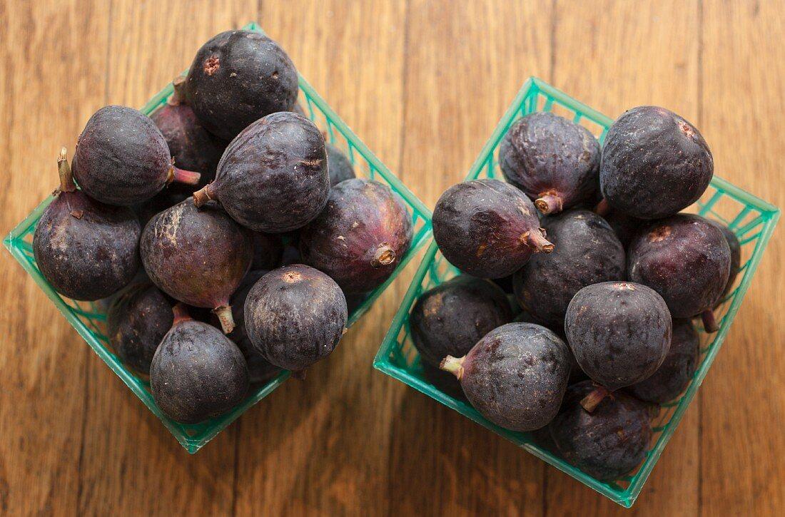 Fresh figs in plastic baskets