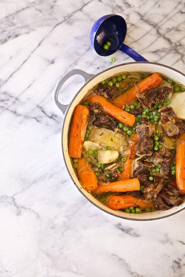 Irish stew with lamb shoulder, potatoes, carrots, onions, and peas (Emerald Isle, Ireland)