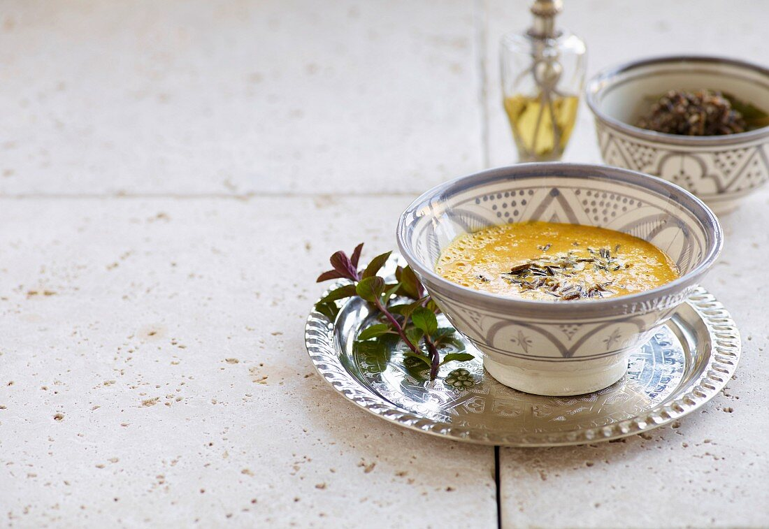 Pumpkin soup with cinnamon and fresh mint
