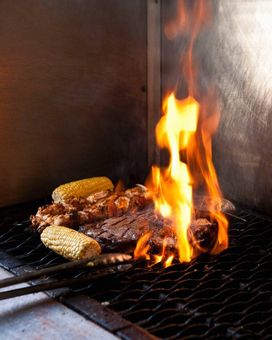 Corn cobs and meet on a barbecue at 'The Backyard Grill Lounge', Sea Point, South Africa