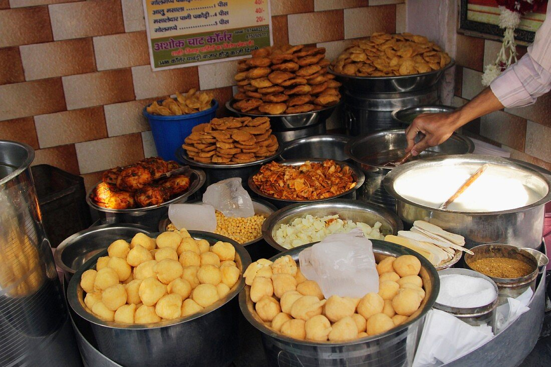 An Indian fast food stand selling various traditional dishes