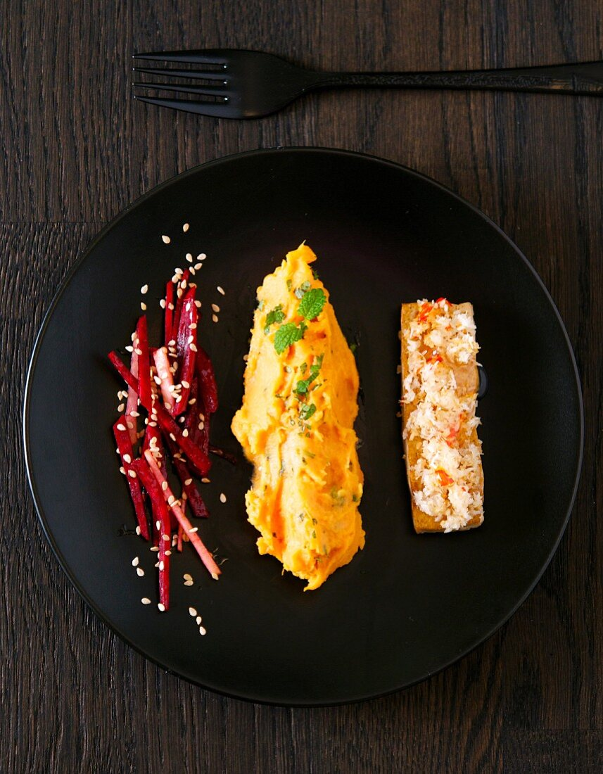 Mashed sweet potato with mint, beetroot with sesame seeds, and coconut and chilli tofu