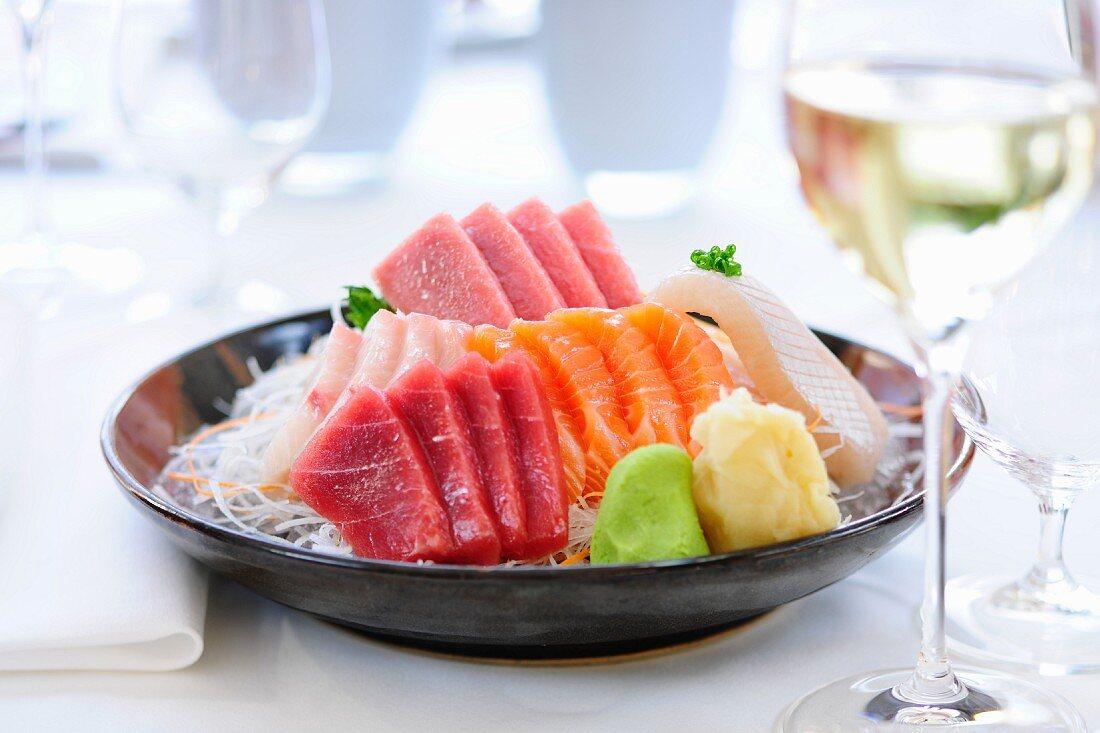 Raw fish sashimi with ginger and wasabi