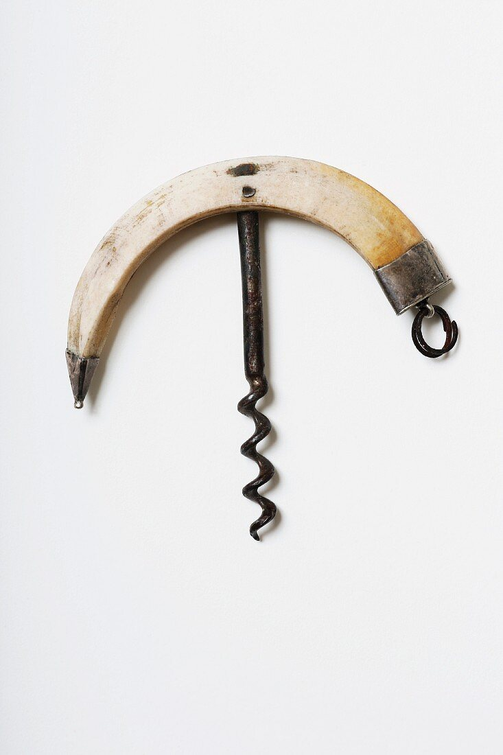 A hog tooth-handle corn screw with a handcrafted spiral and silver adornments, 19th century (Von Kunow Collection)