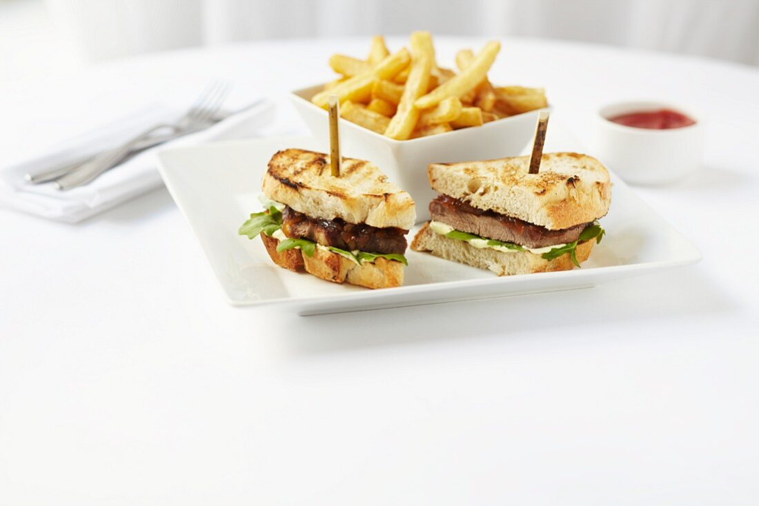 A toasted sandwich with beef, chips and ketchup