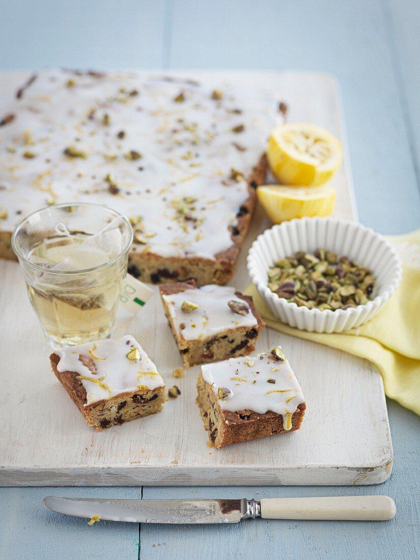 Fruit cake with nuts and lemon glaze