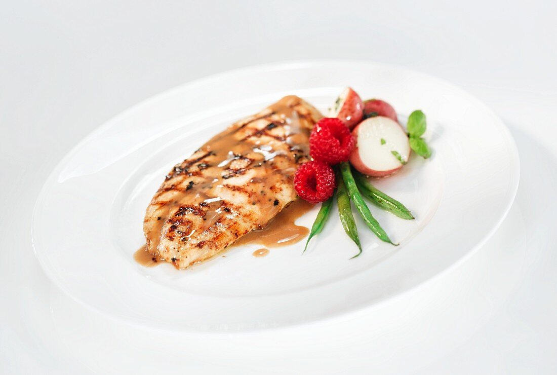 Grilled chicken breast with a raspberry and balsamic sauce