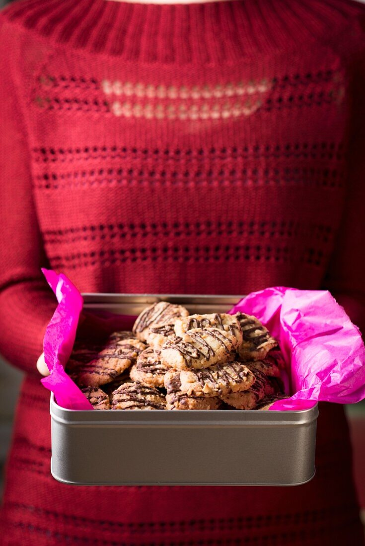 Chocolate and hazelnut biscuits in a silver tin