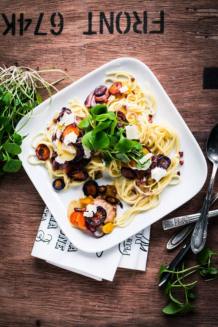 Tagliatelle with slice turnips, feta cheese and purslane