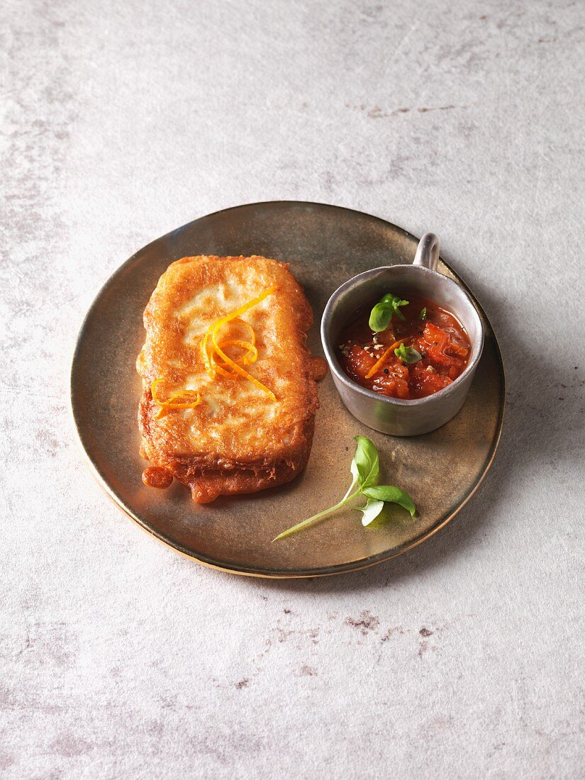 Vegetarian tofu piccata with orange and tomato sauce