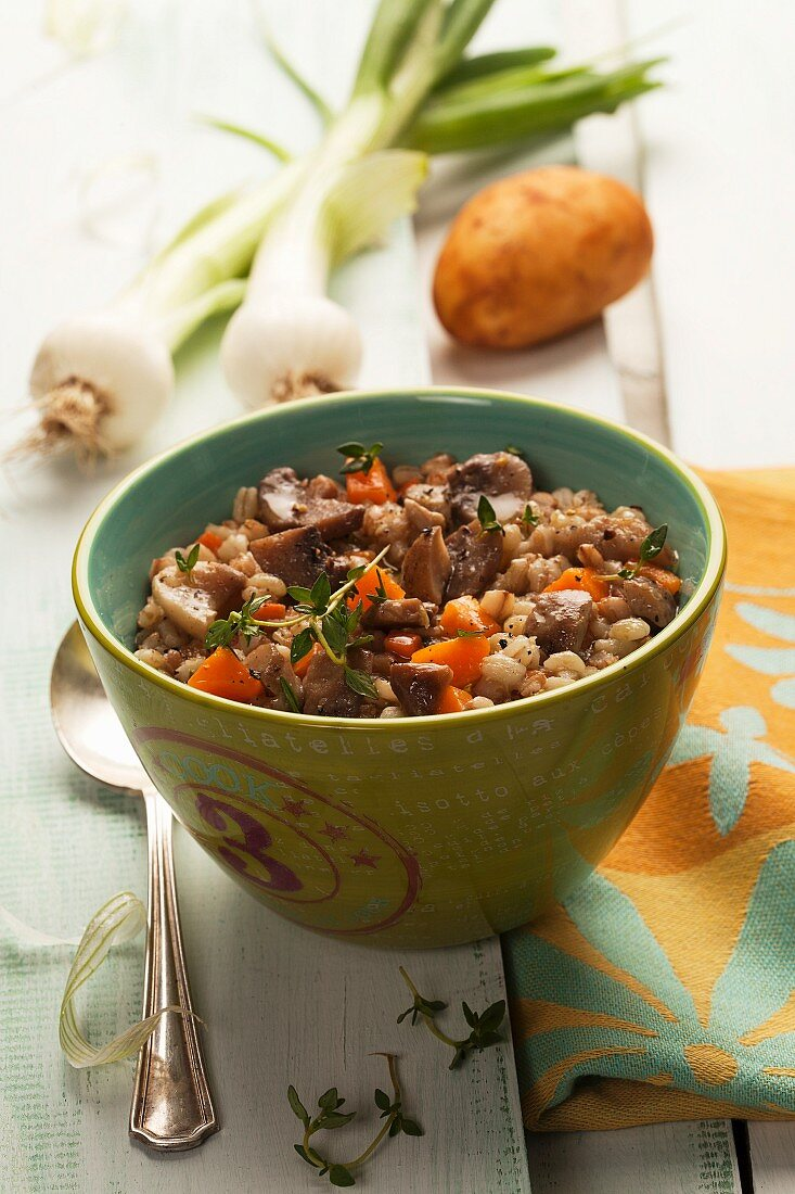 Grain soup with mushrooms, carrots, onions and potatoes