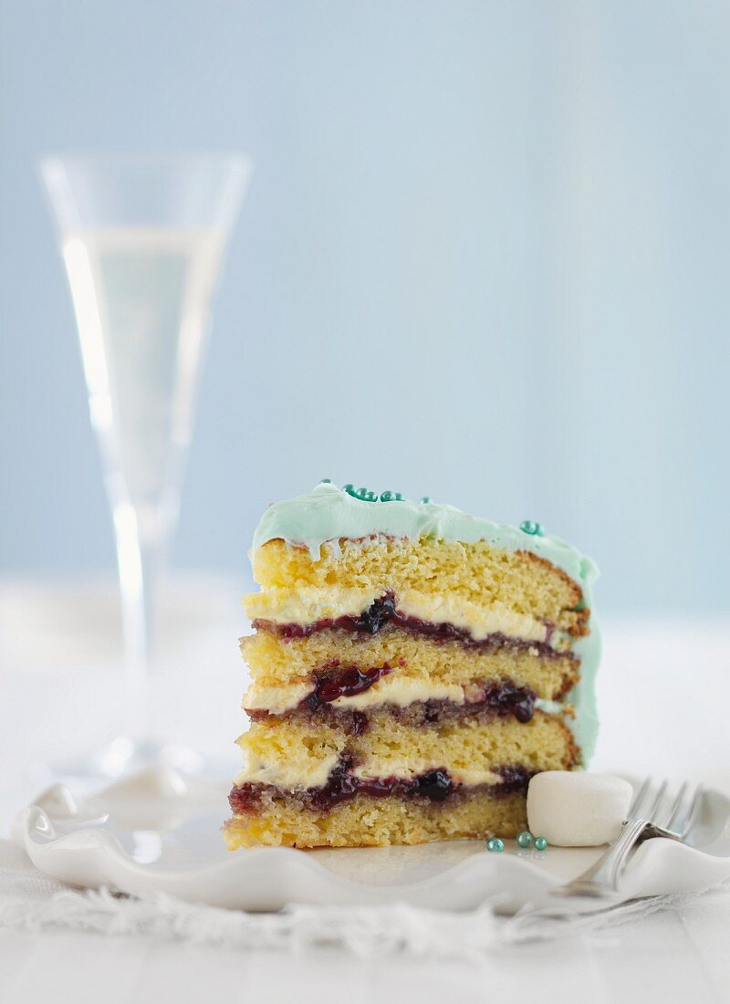 A slice of layer cake with butter cream and jam for Christmas