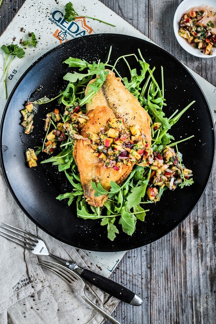Plaice with nectarine salsa and rocket