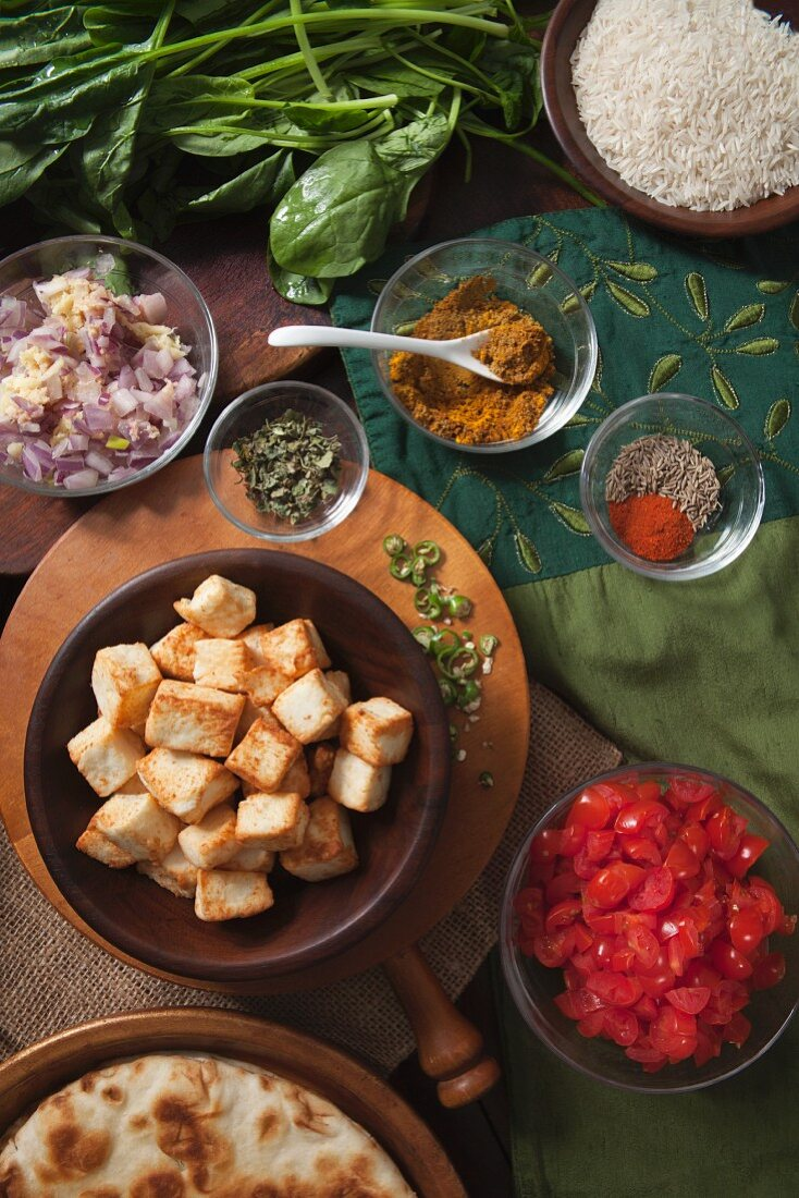 Ingredient and spices for Saag Paneer (cheese dish with spinach, India)