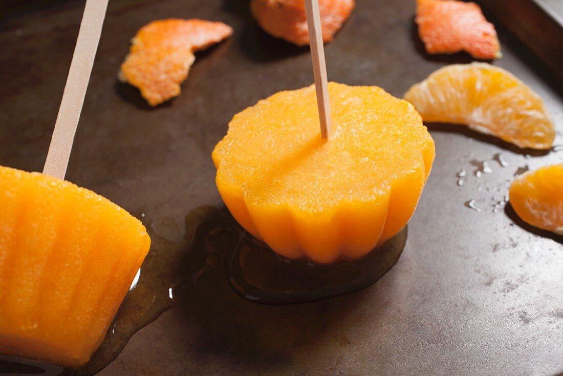 Homemade orange ice lollies