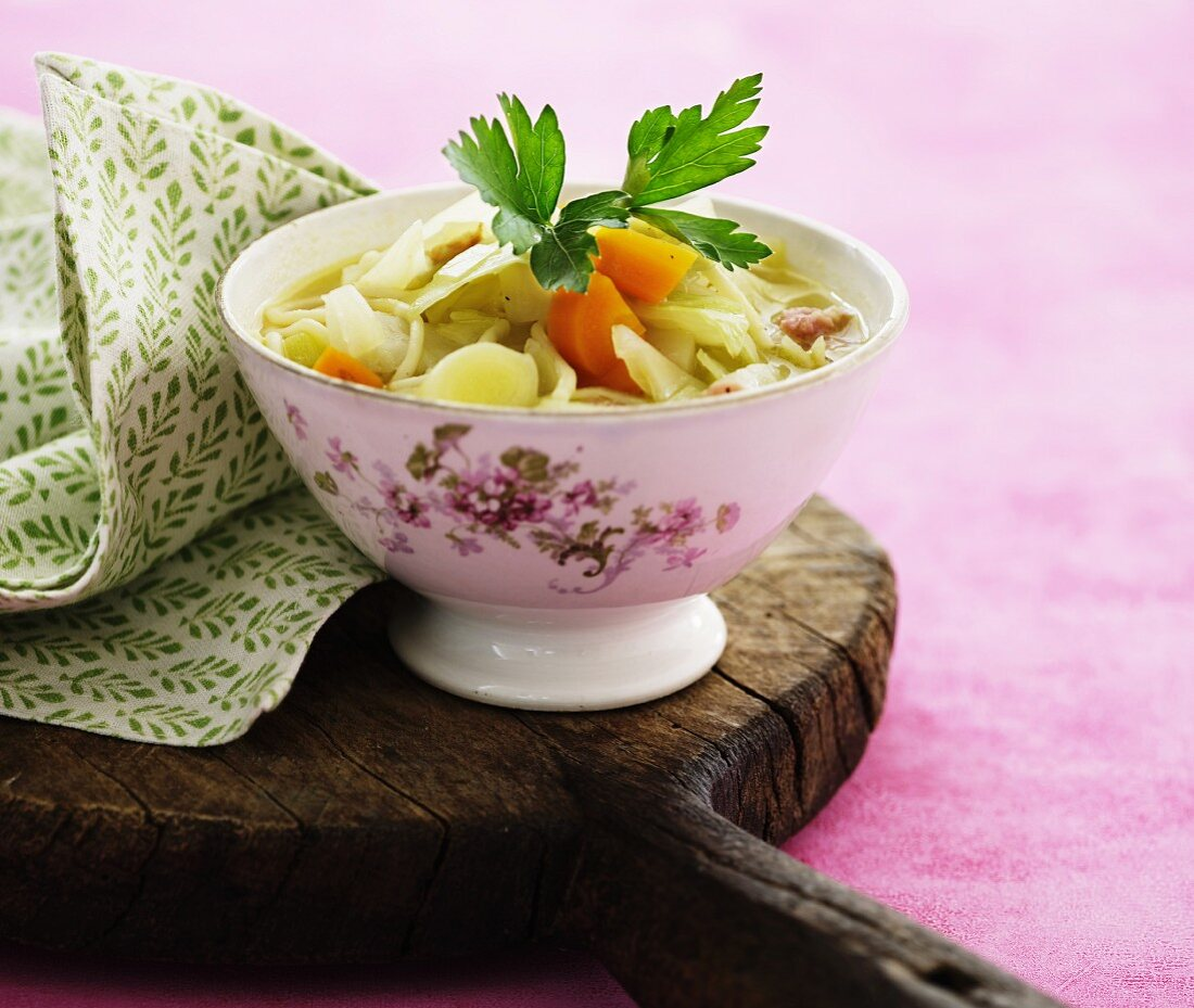 Cabbage soup with carrots and leek